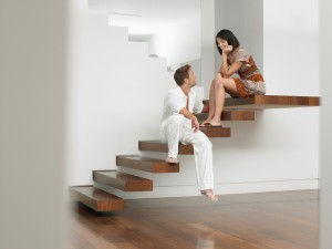 Floating metal stairs in modern new home
