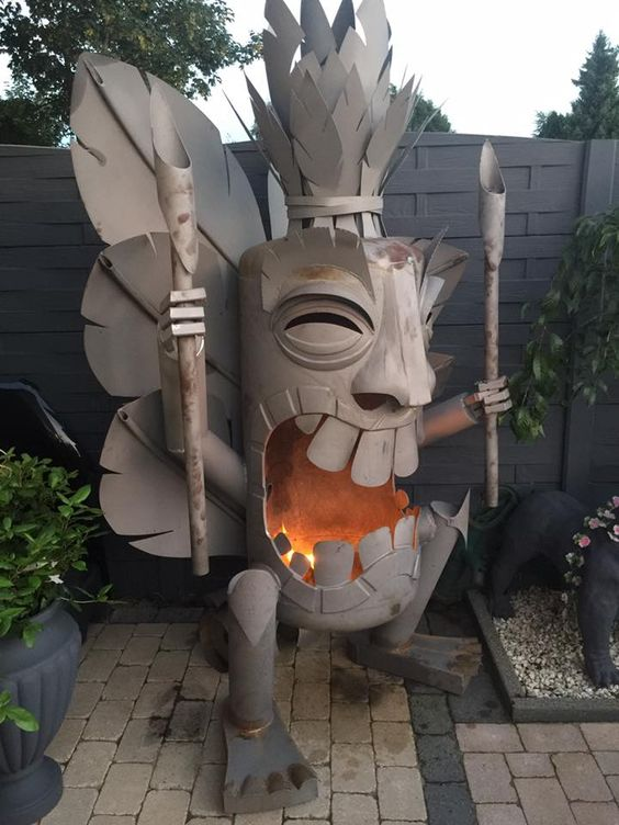Metal tiki firepit in someone's backyard
